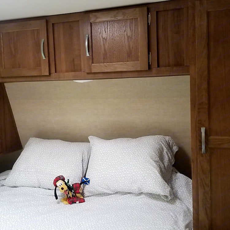 PRIVATE Master bedroom with shirt closets and overhead cupboards