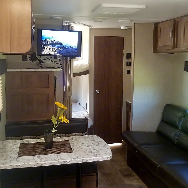 Dining and entertainment area with TV with DVD and Roku