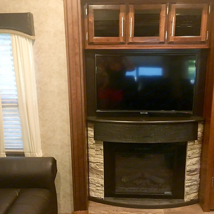 Has 37 inch TV with DVD player and surround sound.