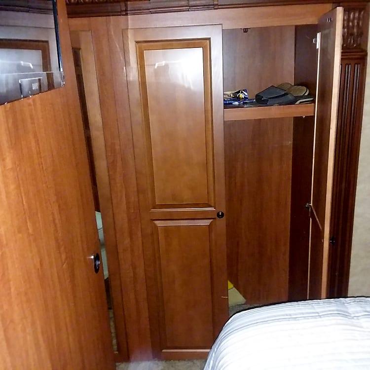 Double door closet with top shelf.