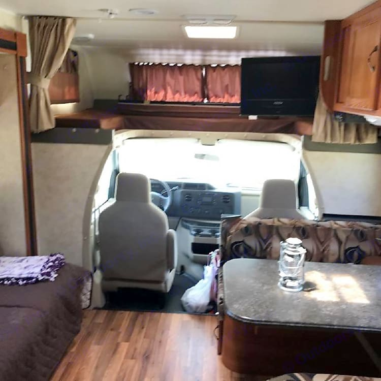 Dining, living, cab and over cab bunk