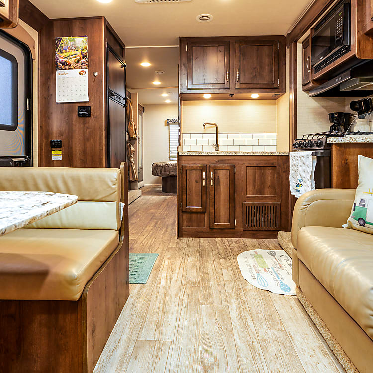 Couch folds out, sleeps 2 children or one adult comfortably. Couch has 2 seat belts built in.