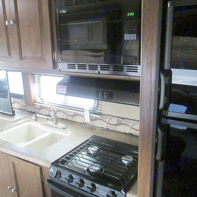 Cooking Area with Microwave, stove and oven.