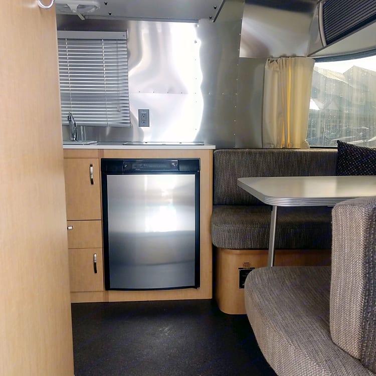 Surprisingly spacious mini fridge with freezer.