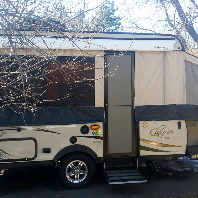 easy set up with an awning, not extended in the photo, but we'll show you how to set it up when you pick up the Clipper!