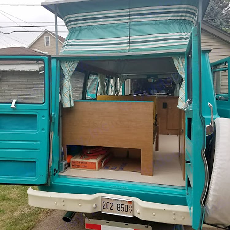 The rear of the CampWagon with the doors open and the poptop up.