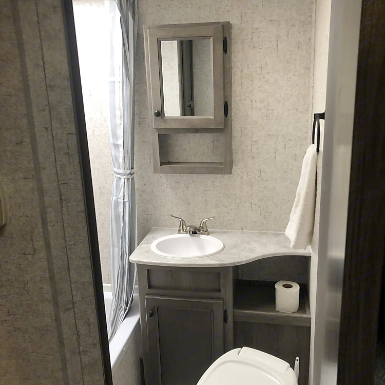 Bathroom, with shower, vanity, and toilet
