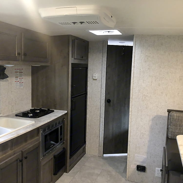 Double sink, stove, microwave and fridge