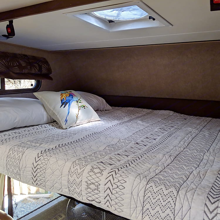 Cabover bed with linens