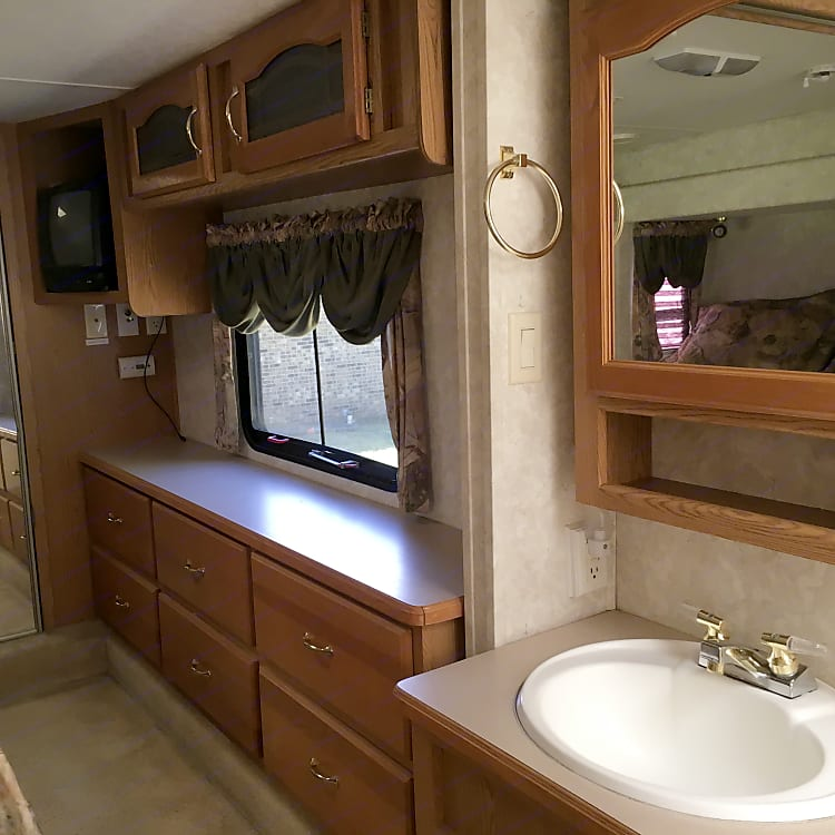 Master suite with queen sleep number bed, plenty of storage and closet space. Television.