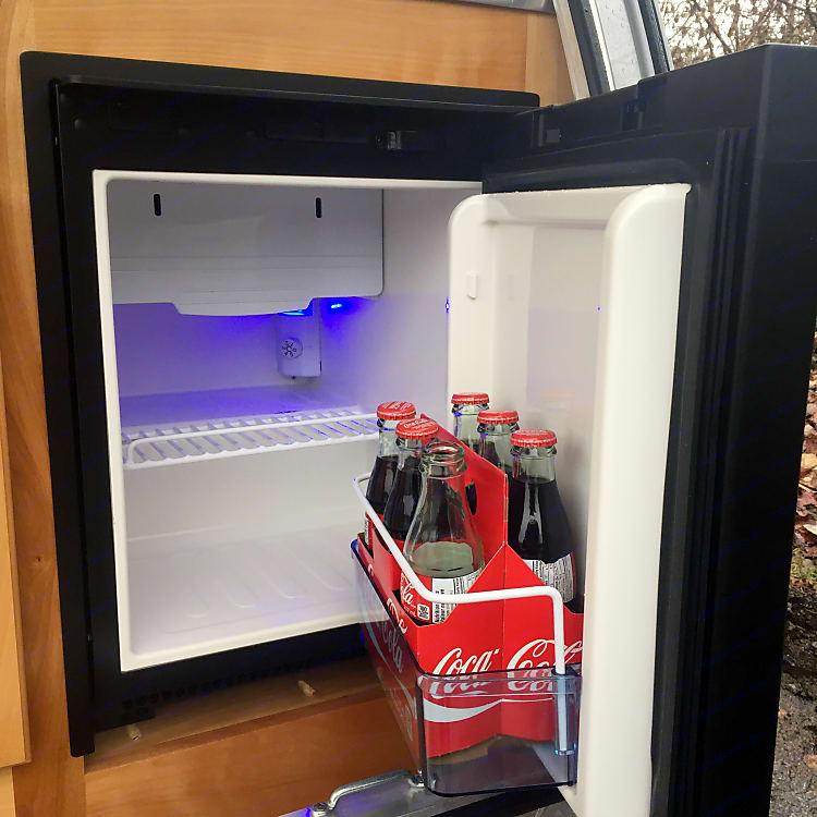 Small 3 way fridge that runs on propane, 12V and 110V.