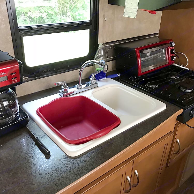 Two tub sink, propane stove and of course, coffee pot!