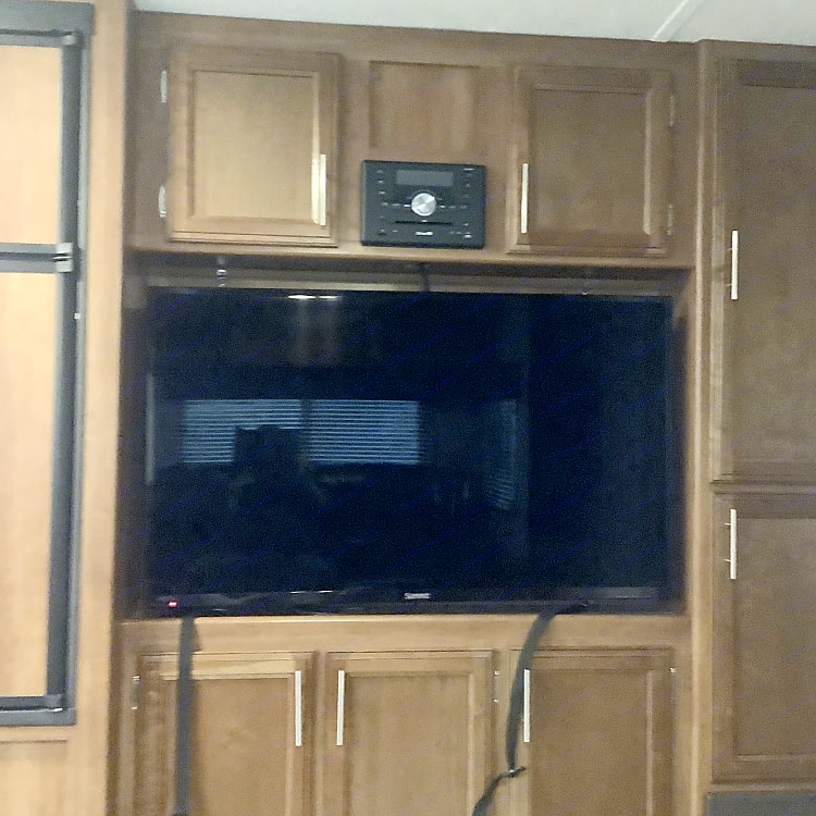 50 inch tv with radio entertainment center.