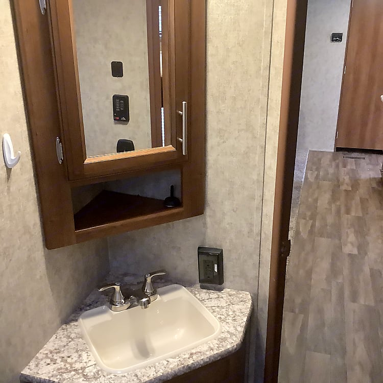Complete bathroom with storage.