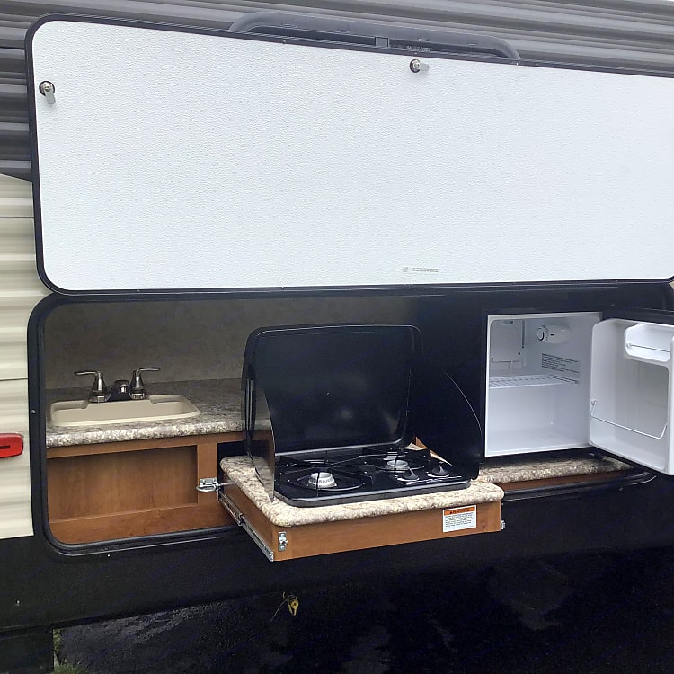 Complete outdoor kitchen. Two burner stove ,sink, refrigerator. Don't be stuck inside be where the action is .