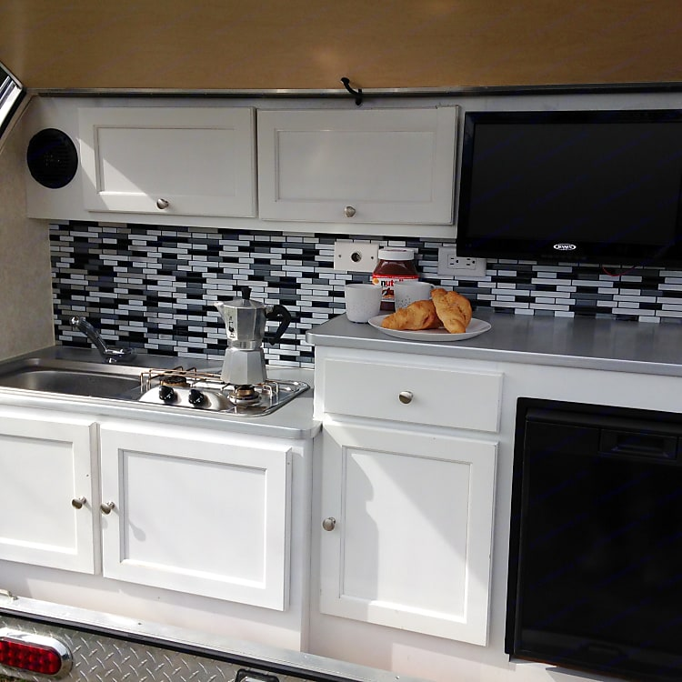 We love our outdoor kitchen. When camping, we spend 80-90% of the time outside anyway.