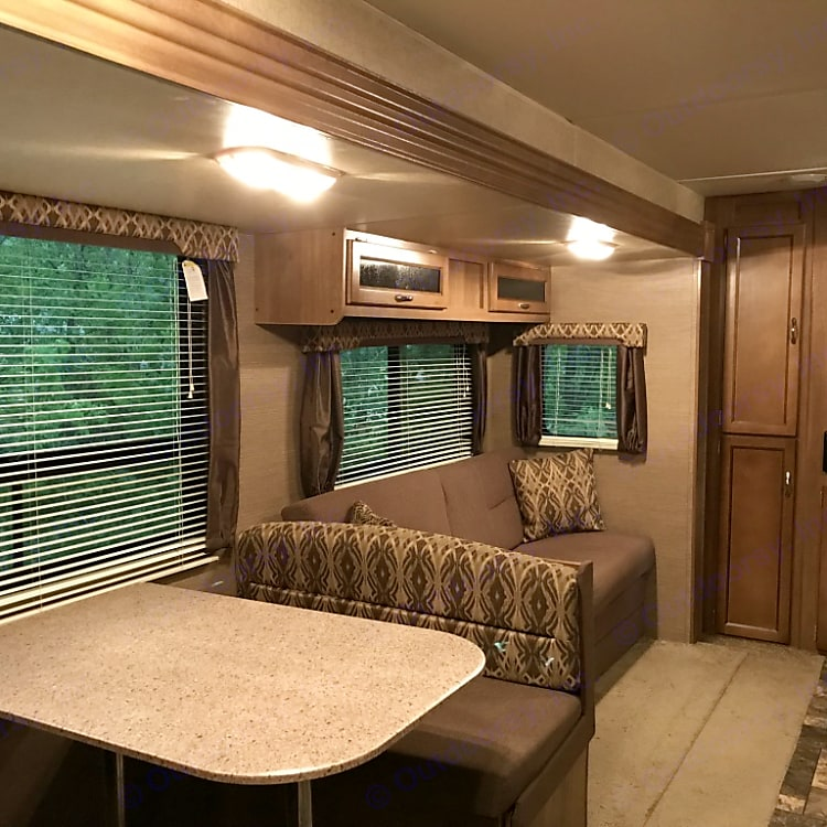 The dinette and couch turn into beds. But the tv doesn't. There is a cribbage board in the cabinet above the couch, so you can impress your friends with your math skills.