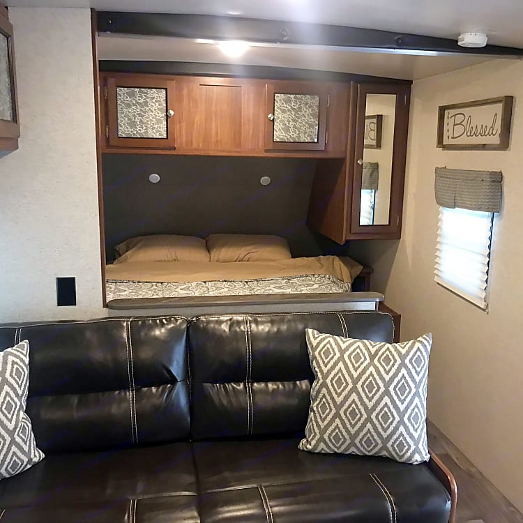 Main queen bed and sleeper sofa.  Bedroom can be separated by a curtain