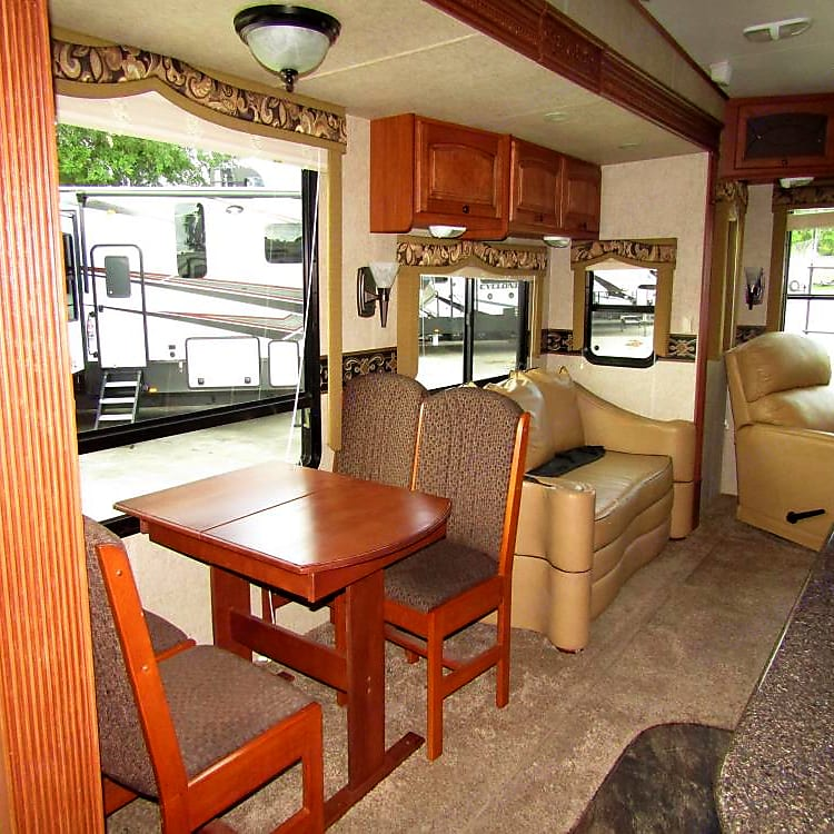 The dining table pulls out and a another section and can be added for your other camping guests or family thanksgiving dinner!! Even hard core RV owners take a second look. I stay real quiet as I can just tell lol.
