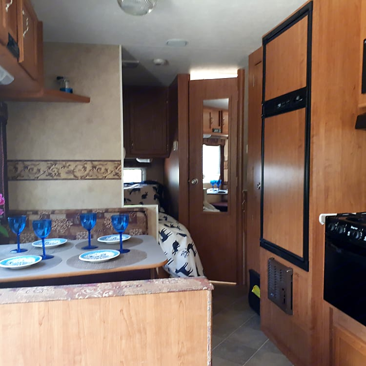 Modern conveniences at your finger tips.  Fully stocked kitchen. Dinette table converts to bed for a little person.