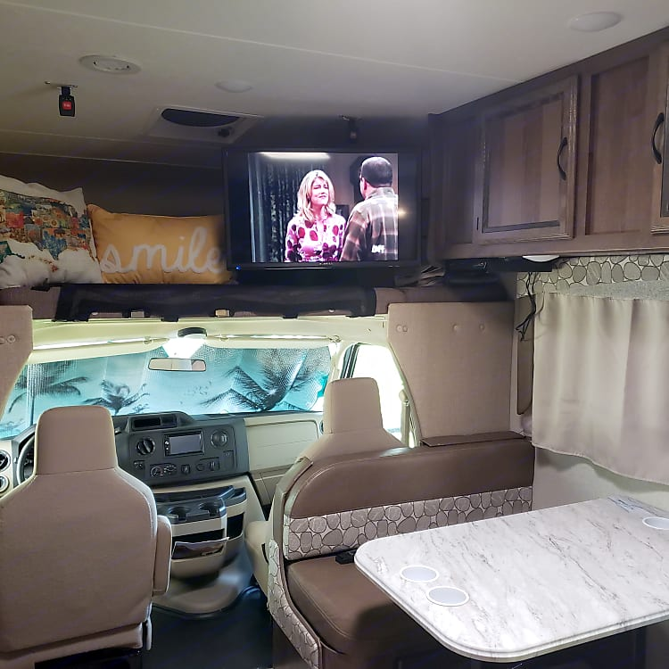 Swing out television in overhead bunk area