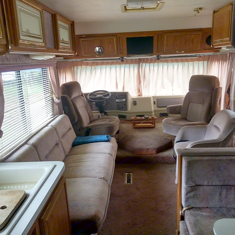Dining and living area. Both dinette and couch fold down to make beds