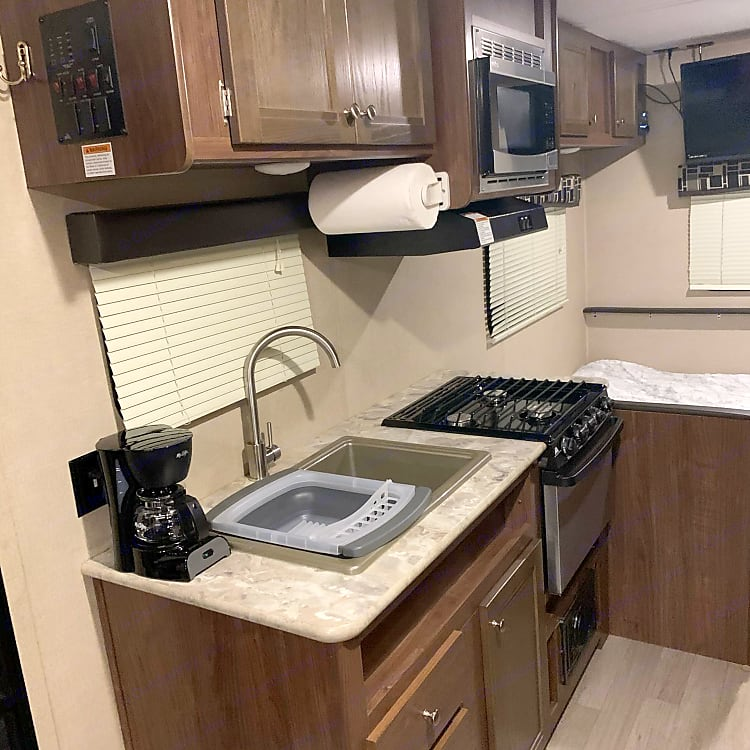 Fully equipped kitchen. Coffee maker, collapsable dish rack, pots, pans and dishes