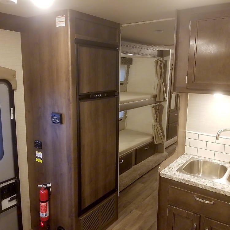 Kitchen sink, fridge, side bunks