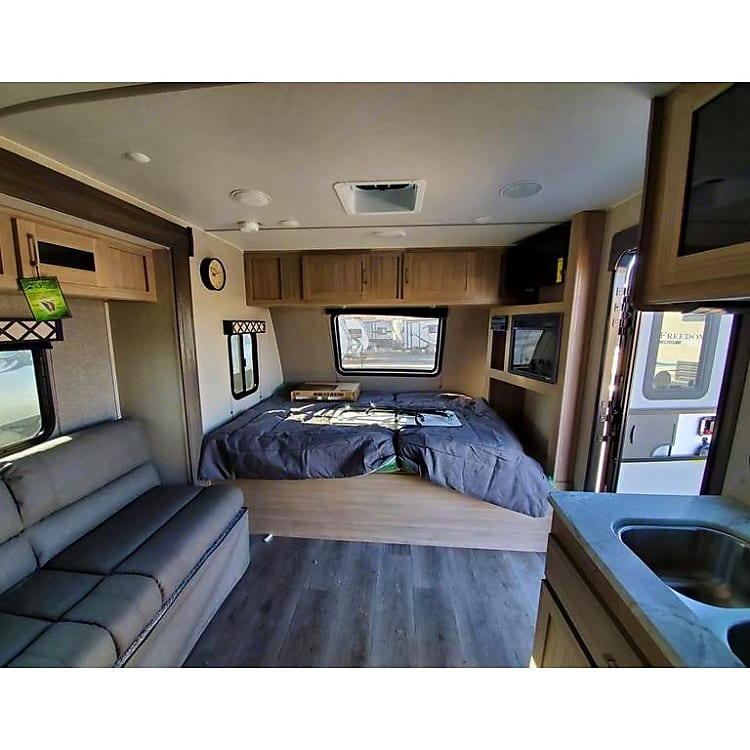 front living, queen bed with viewing window.