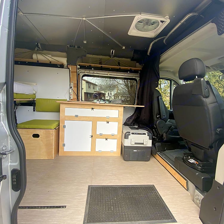 looking in from the side door. the fridge is now located on a slide toward the back of the van