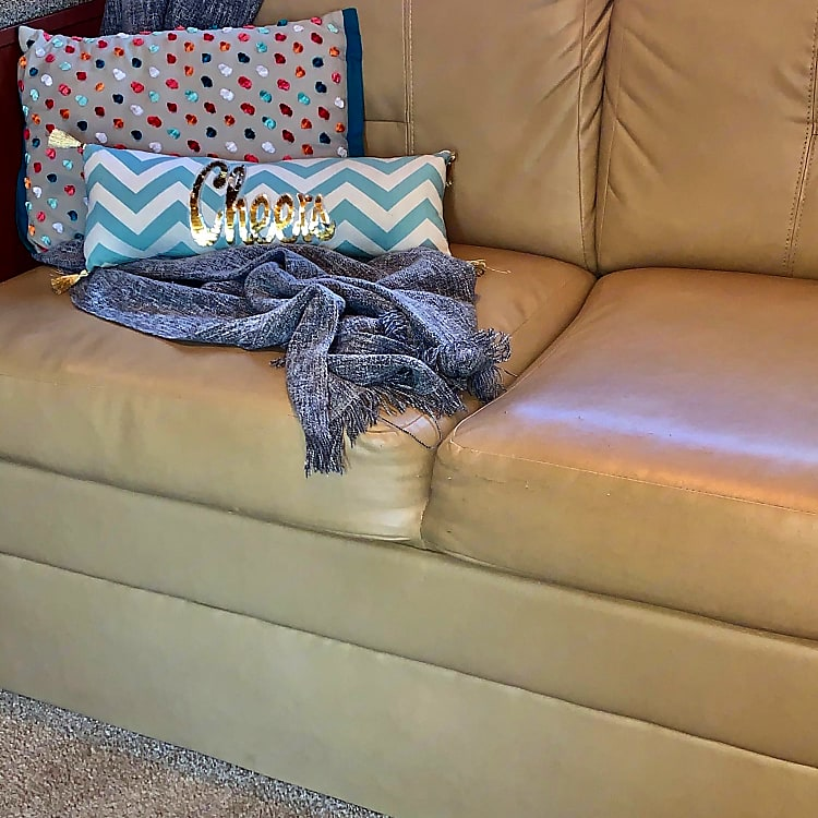 You enter into the interior and the slide-out makes it really comfy. This couch pulls out to a single bed for a child. We store extras under. Nice area to sit, chat, watch TV or read a book while you relax.