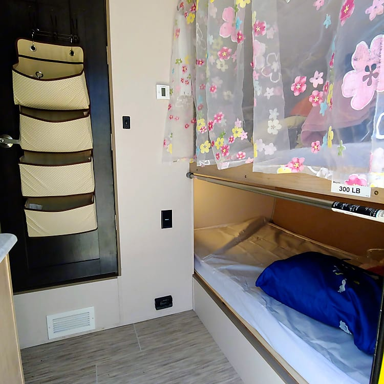 Two spacious twin bunks with reading lights provide a comfortable place for your kids to hang out, rest, and sleep.