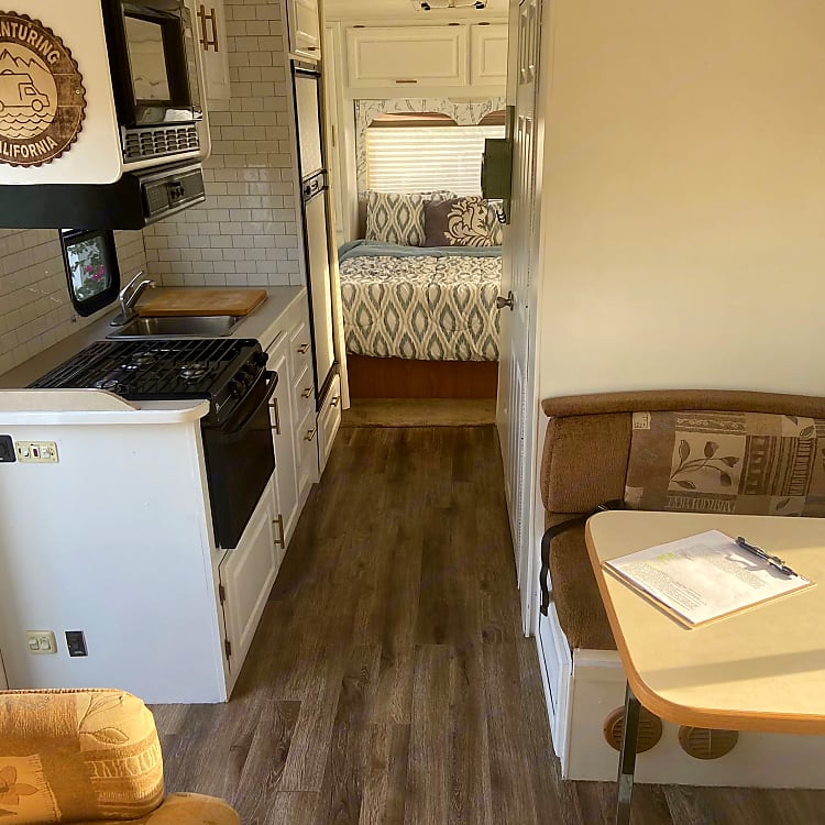 This cozy dining nook gives you two bench seats and seating for 4.  This dinette converts and serves as a twin bed.