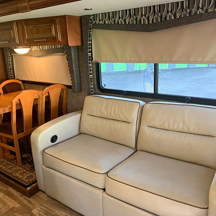 Huge Slide-out with Sleeper Sofa and Table