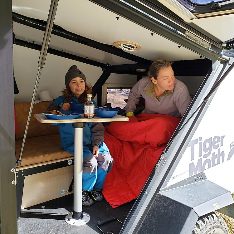 Convert the bed to the table and seat.  The gullwing door provides epic views while you dine!