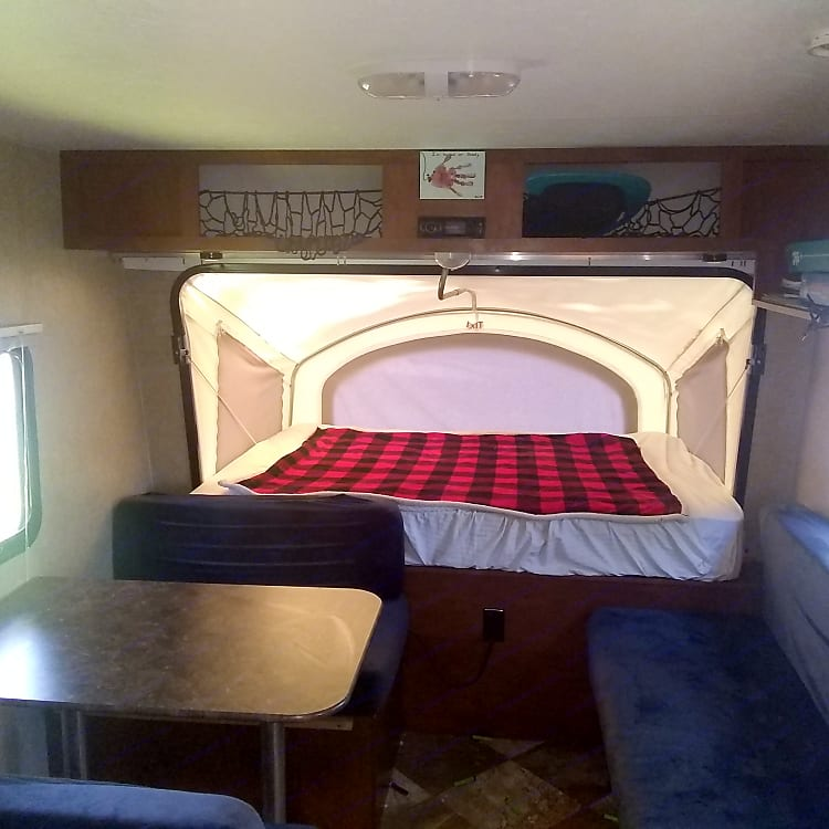 Kitchen table and bench both turn into beds. Stereo system throughout camper.