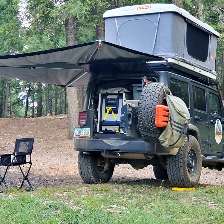 """Equipped with a roof top tent, awning, fridge, stove, cutting board, and cabinets- everything needed for a """"Bed and Breakfast""""!"""