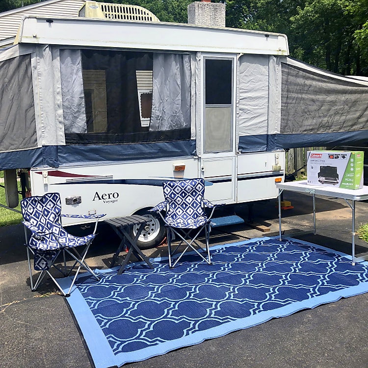 Camp chairs, table, and rug included
