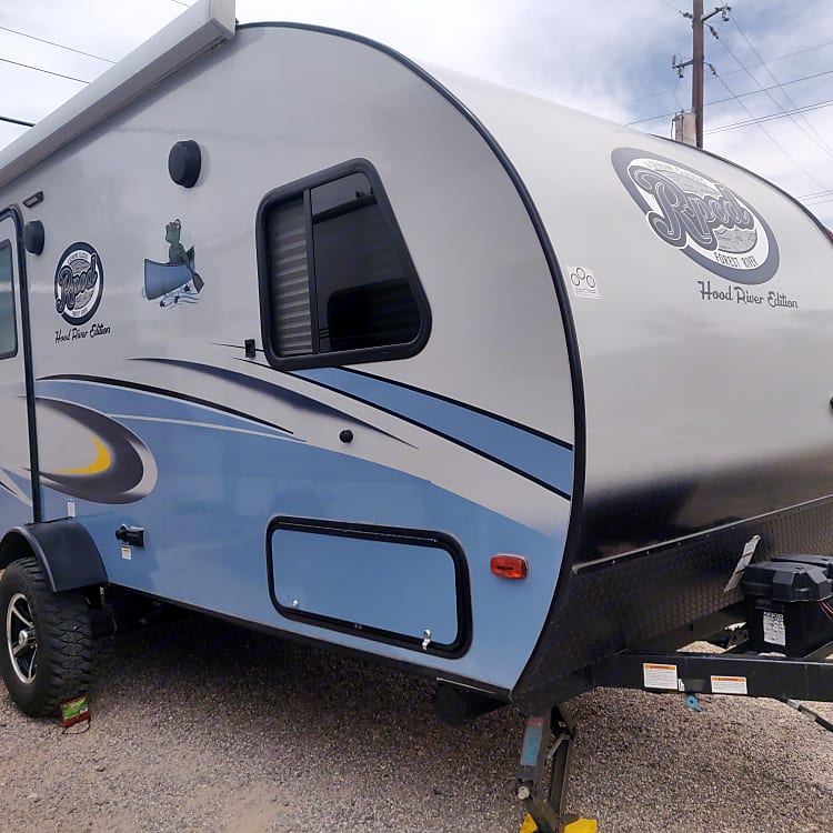 Entry side of the trailer- has outdoor speakers and an awning.