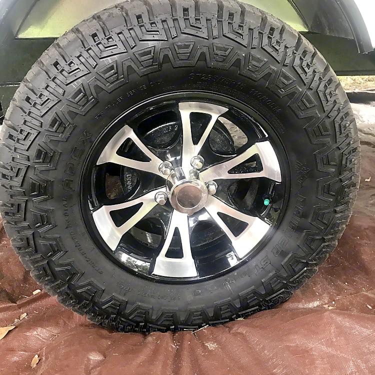 15 inch mud tires with aluminum rims.