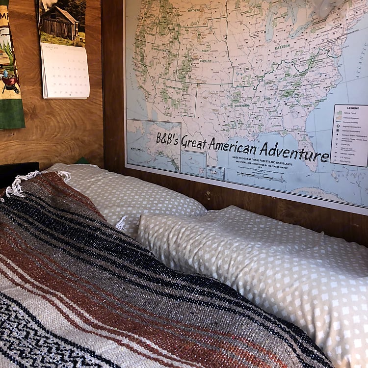 Full size bed and a map of our travels moving from Oregon back to Minnesota