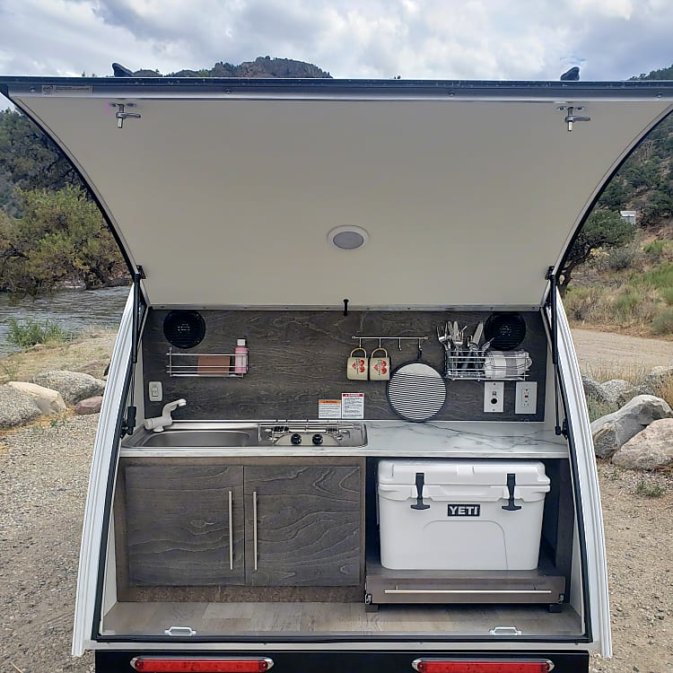 Galley with 2 propane burners, sink, and Yeti Tundra 35