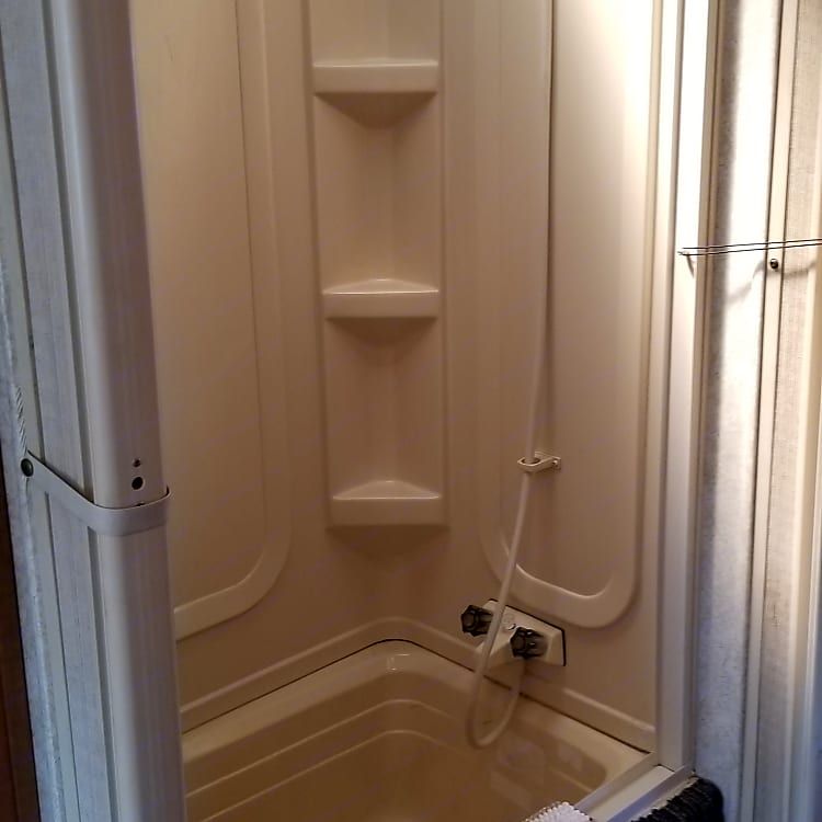 These doors work, but please be gentle.  You can get about 12-15 showers if you are frugal with onboard water.
