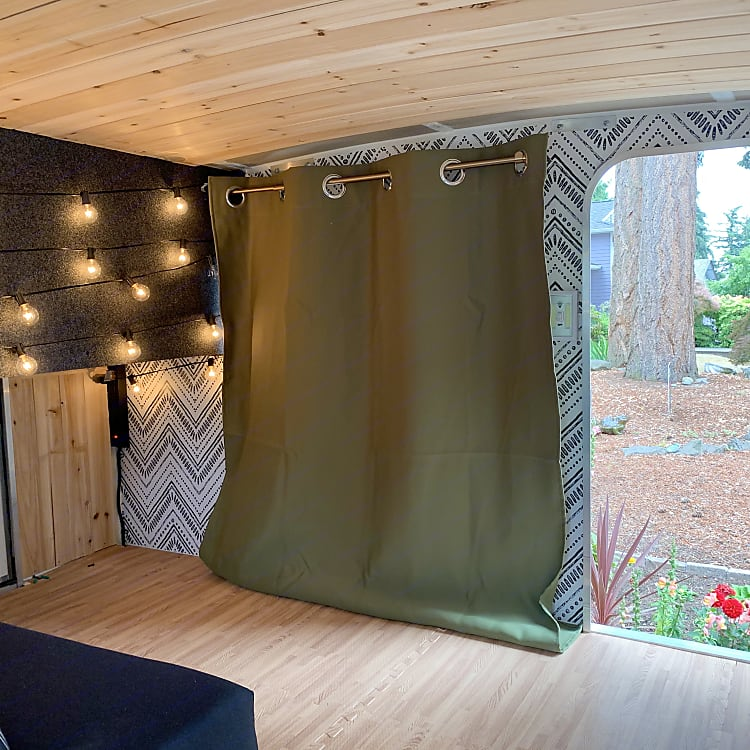 Soft foam wood grain flooring and black out curtains for ultimate comfort.