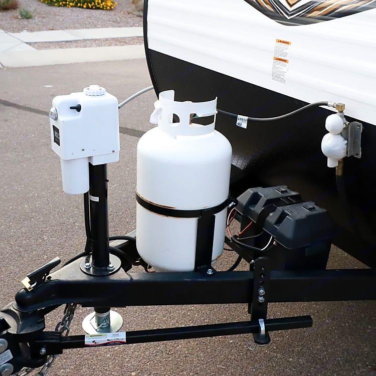 Jack, propane tank and battery.