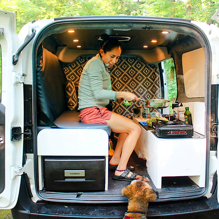 Rained out or just want to chill out? There is enough space to cook inside with our fold away bed.