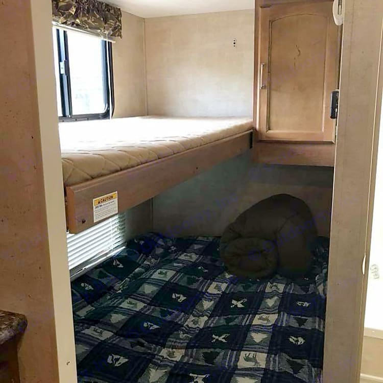 Rear Bed and Bunk (top bunk folds up to accommodate additional headroom for bed below)