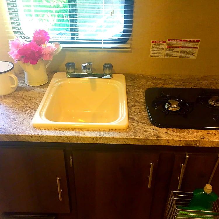 Sink and 2 burner kitchen