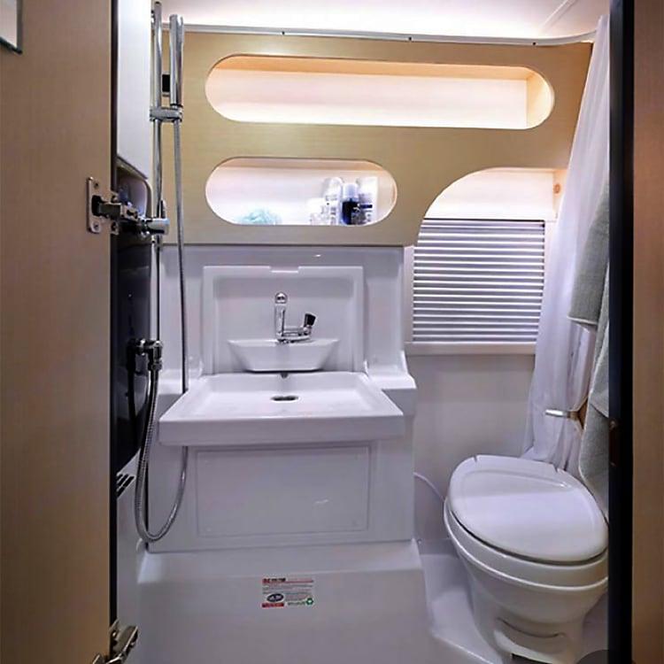 State of the art wet bath: heated, full shower, USB plugs, lots of storage, fan, portal window with screen.