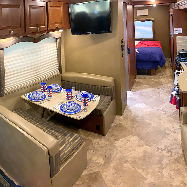Spacious interior with booth dinette
